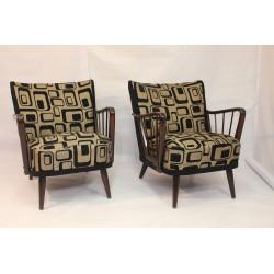 Paire de fauteuils année 50 accoudoirs rayons.