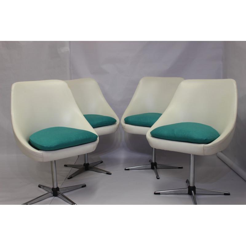 4 vintage swivel armchairs